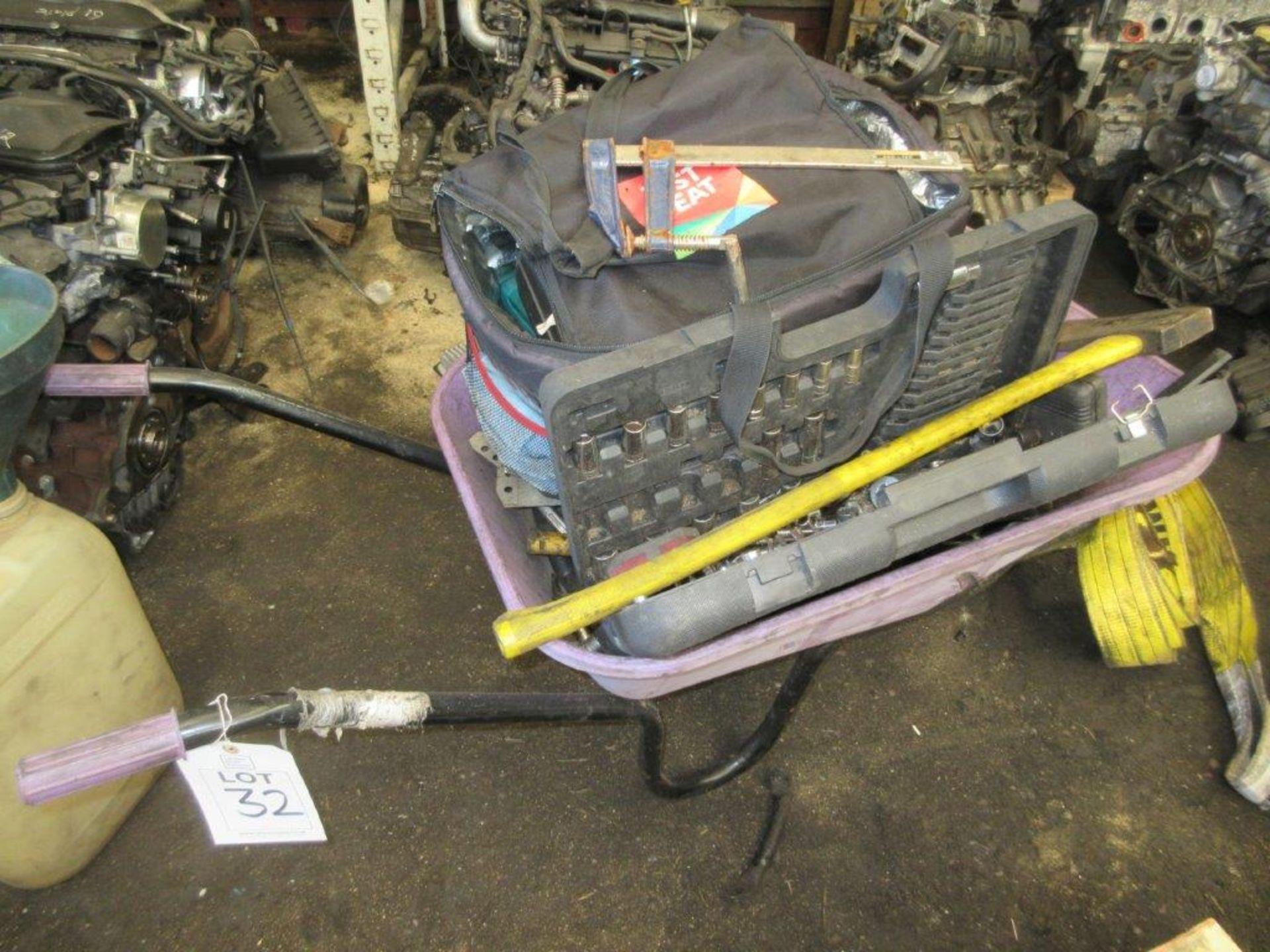 Lot 32 - Plastic wheelbarrow and contents of hand tools, socket sets etc.