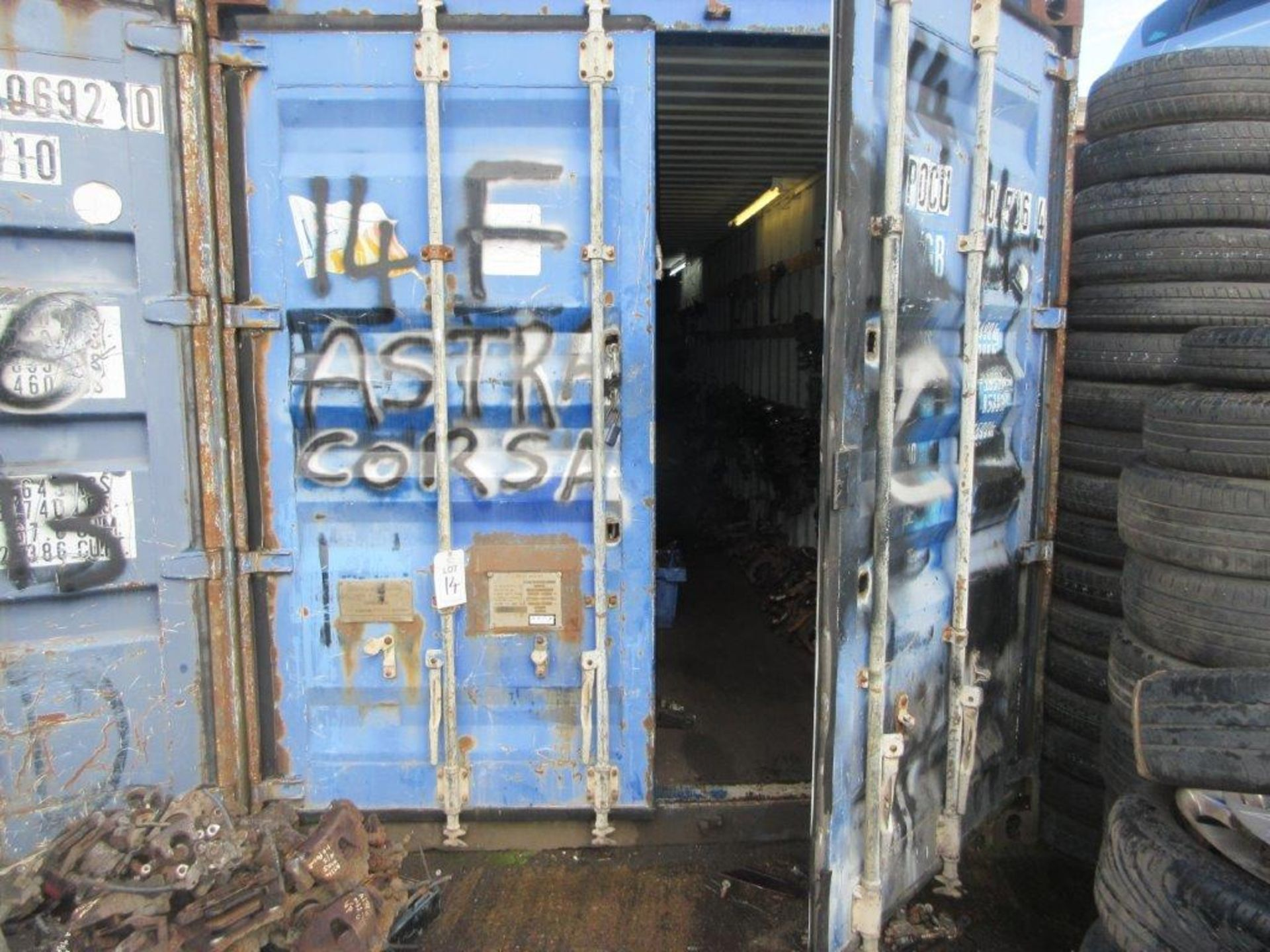 Lot 14 - Blue steel shipping container, 40 ft. x 8 ft. approx. plus rack and contents of mainly Vauxhall