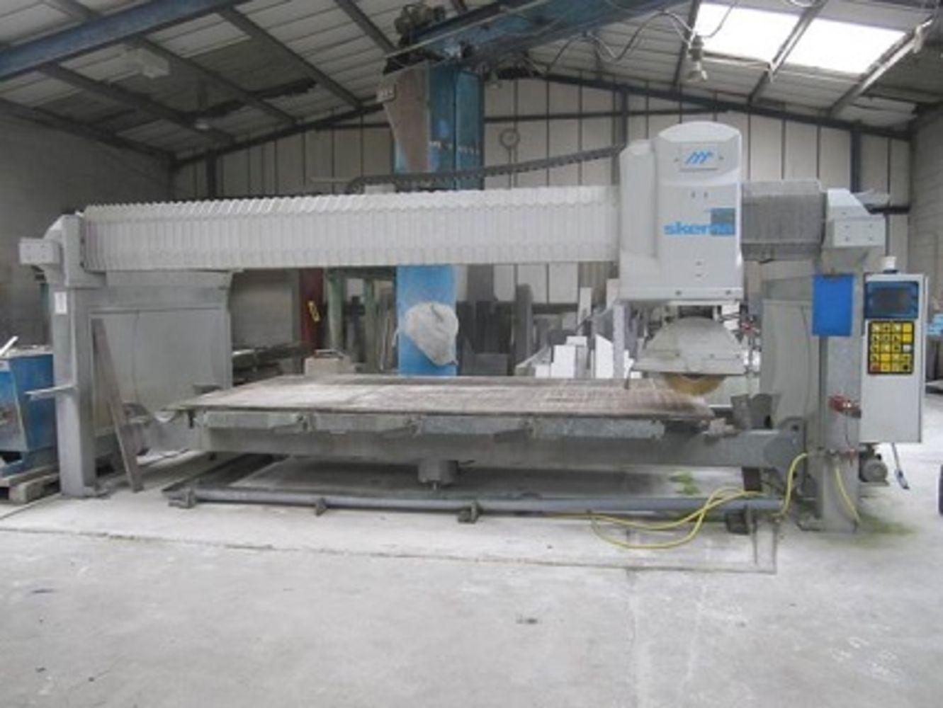 Trebarwith Stoneworks Ltd - Range of modern stone cutting/processing machinery, forklift, stone stock, tools, etc.