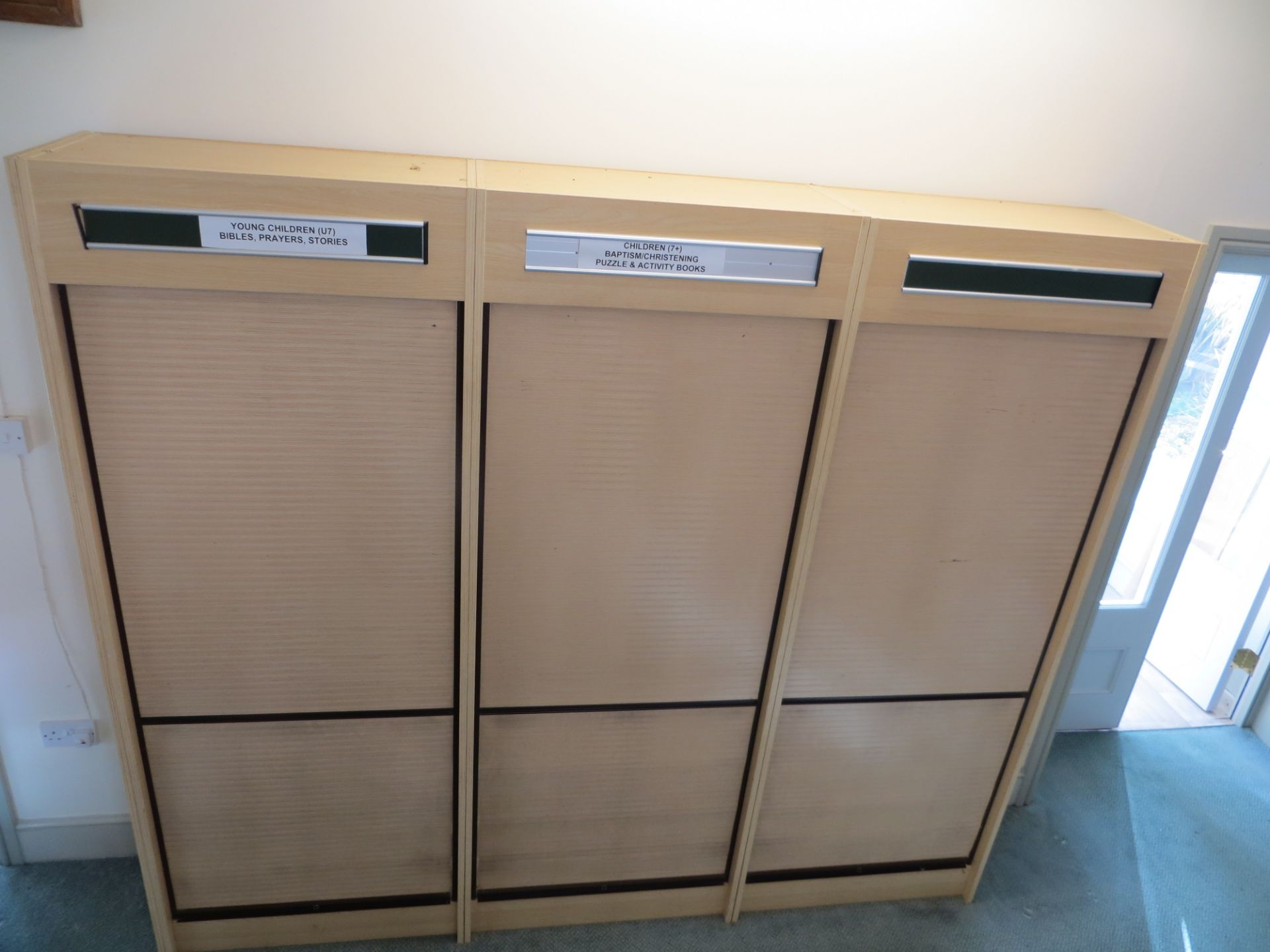 Lot 390 - Four tambour fronted cabinets L 800mm x W 400mm x H 2100mm