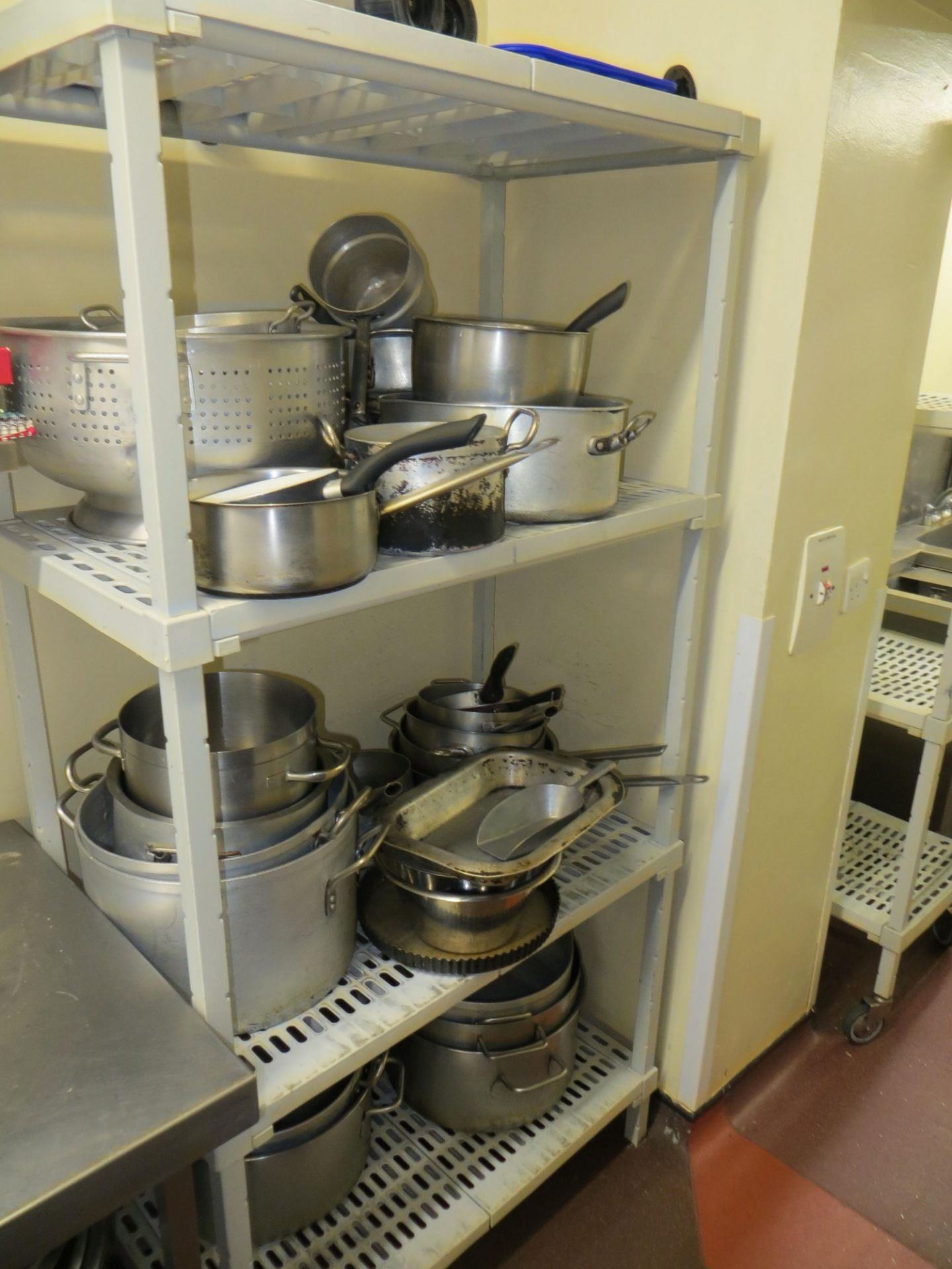 Lot 60 - 4 tier catering unit and contents to include pots & pans and 2 stainless steel shelves and