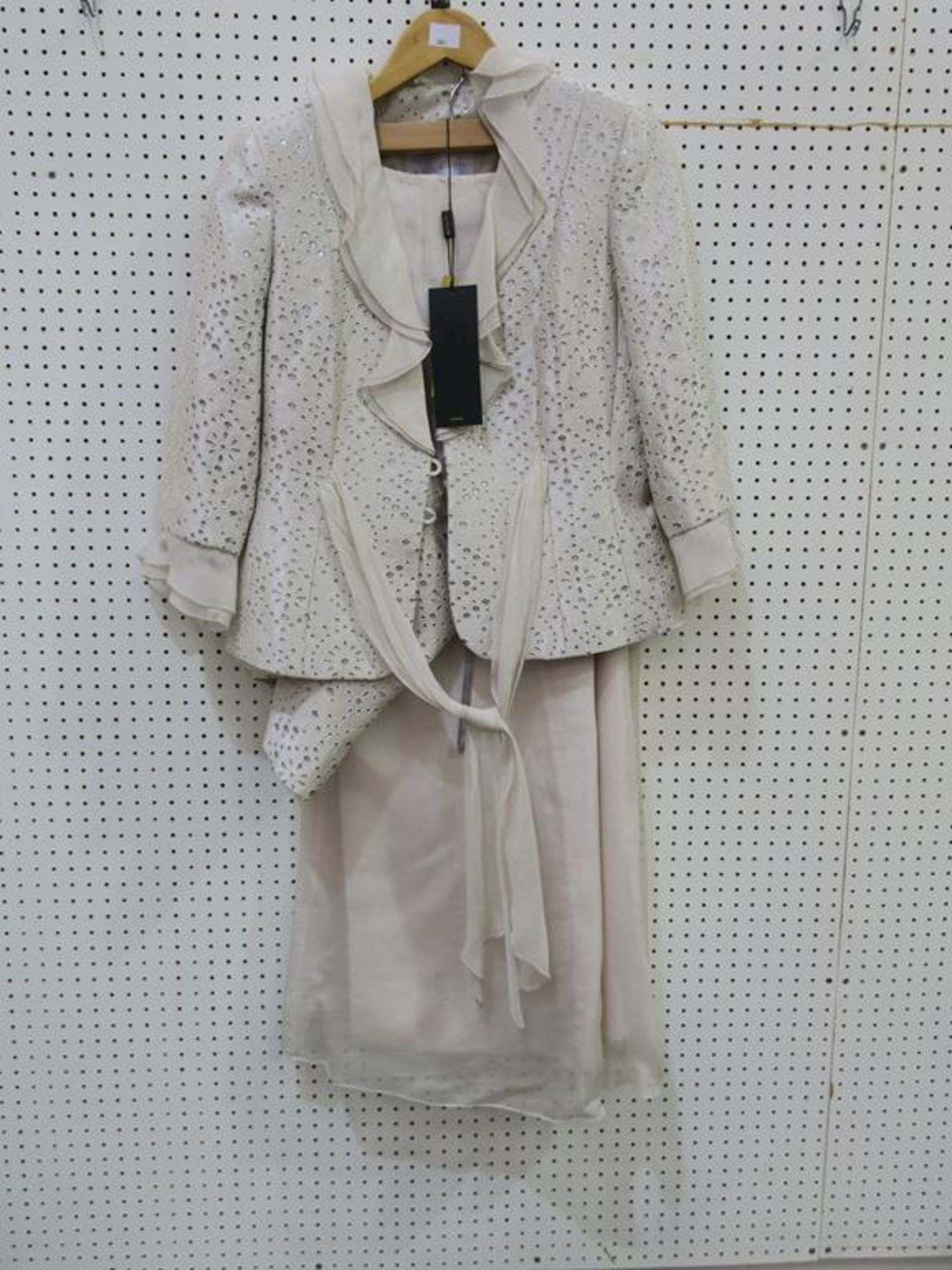 Lot 8041 - * Two Ladies Garments. An Ispirito (size 12, RRP £579) and a Luis Civit (size 12, RRP £664).