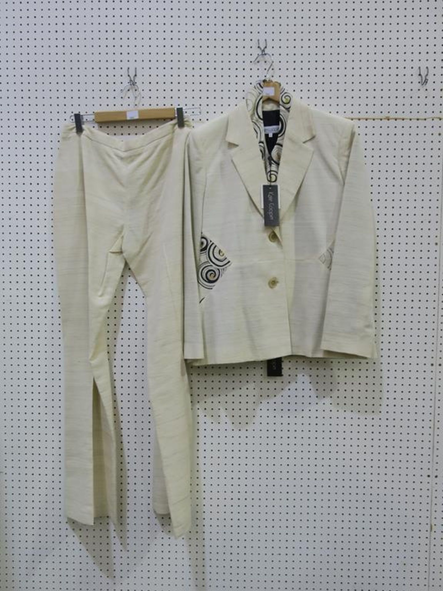 Lot 8044 - * Three Ladies Garments. A Kate Cooper (size 12, RRP £312), a Contini (size 18, RRP £500) and a Veni