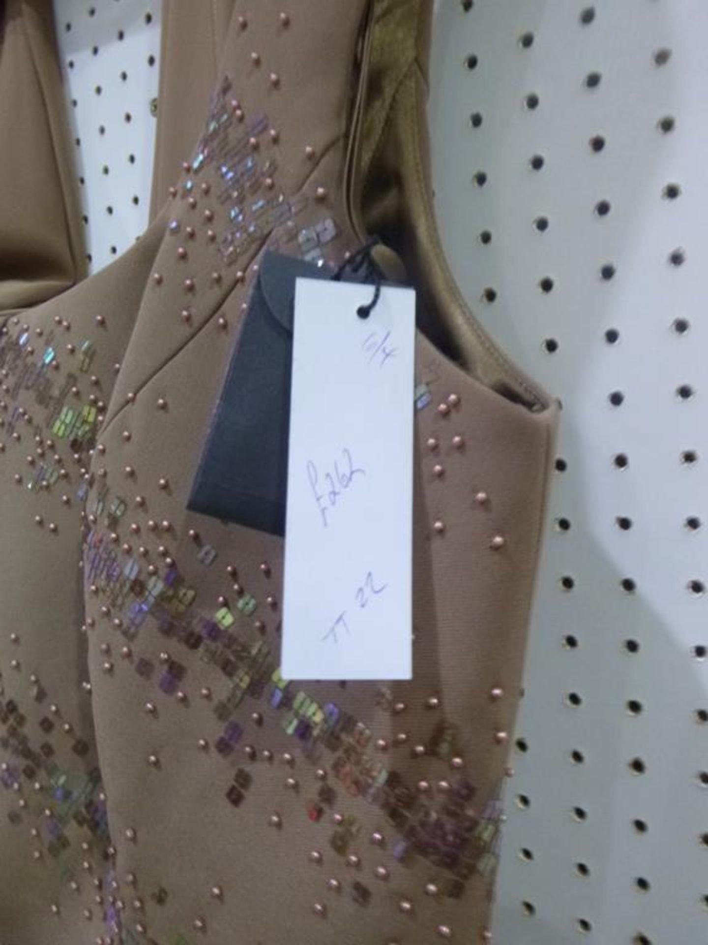 Lot 8019 - * Two Ladies Garments. A Simon Ellis (size 12) and a Veni Infantino (size 16). Please see