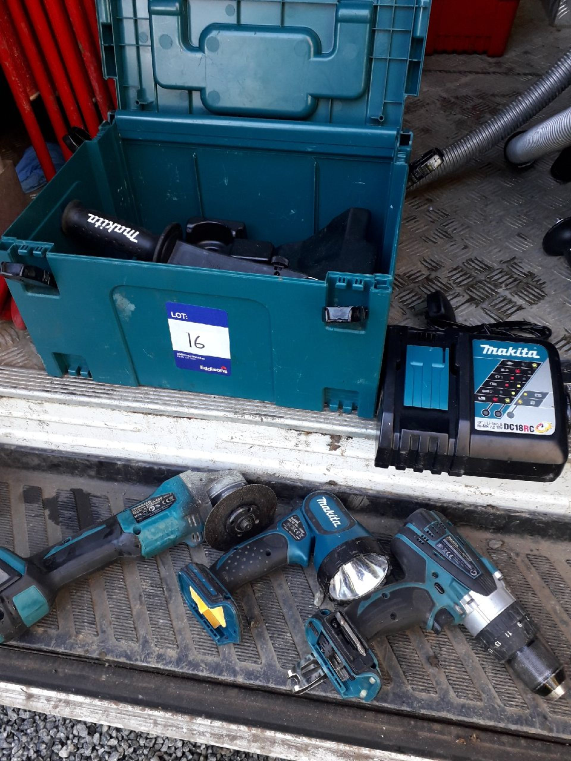 Lot 16 - Cordless Makita tools consisting of Makita fast charger, Makita DHP458 cordless hammer drill, Makita