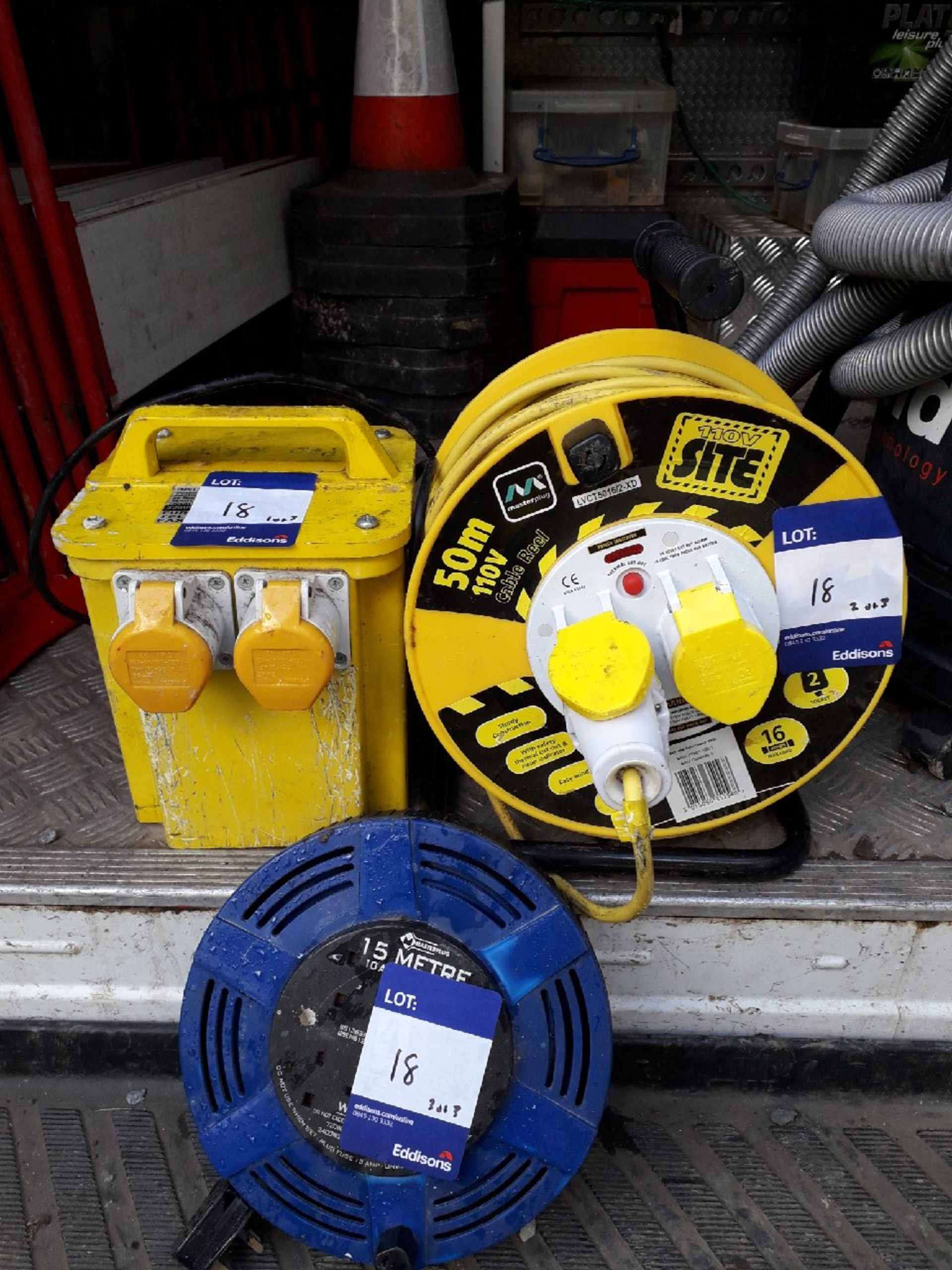 Lot 18 - 1 x Transformer double socket 240v to 110v, 1 x 2 socket 50m cable reel 110v, 1 x 15m cable reel (