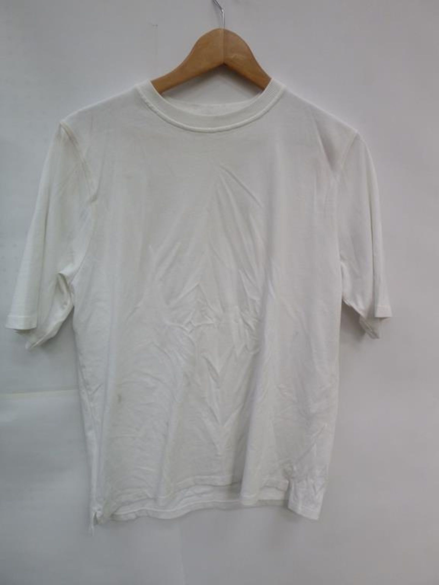 Lot 726 - Three White Short Sleeve T-Shirt (2 XS, M), White Long Sleeve Jacket (S), Bright Yellow 'MX ISM' T-