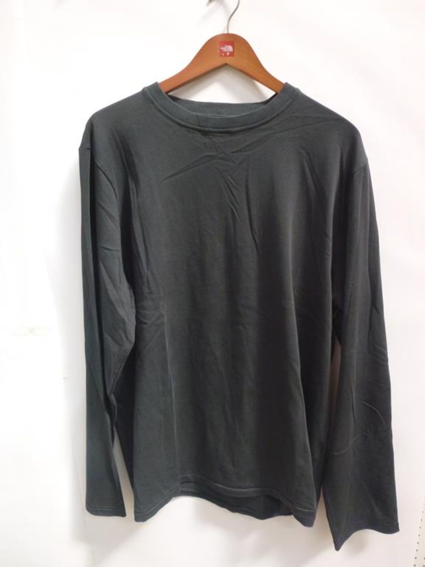 Lot 703 - A Long Sleeved White T-Shirt (M), a Lemaire Short Sleeved T-Shirt (?), 5 x Long Sleeved Black Tops (