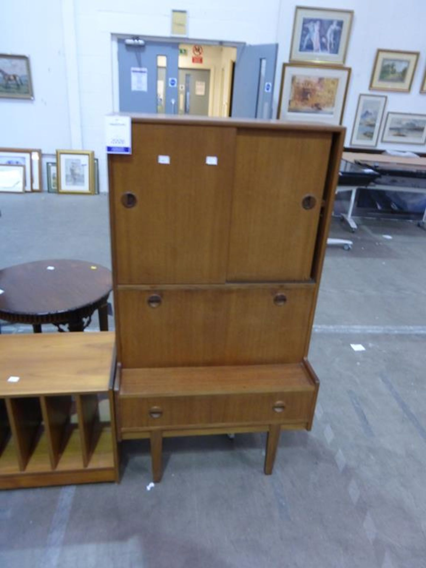 Lot 2008 - A Teak Drinks Cabinet with a Matching Music Stand