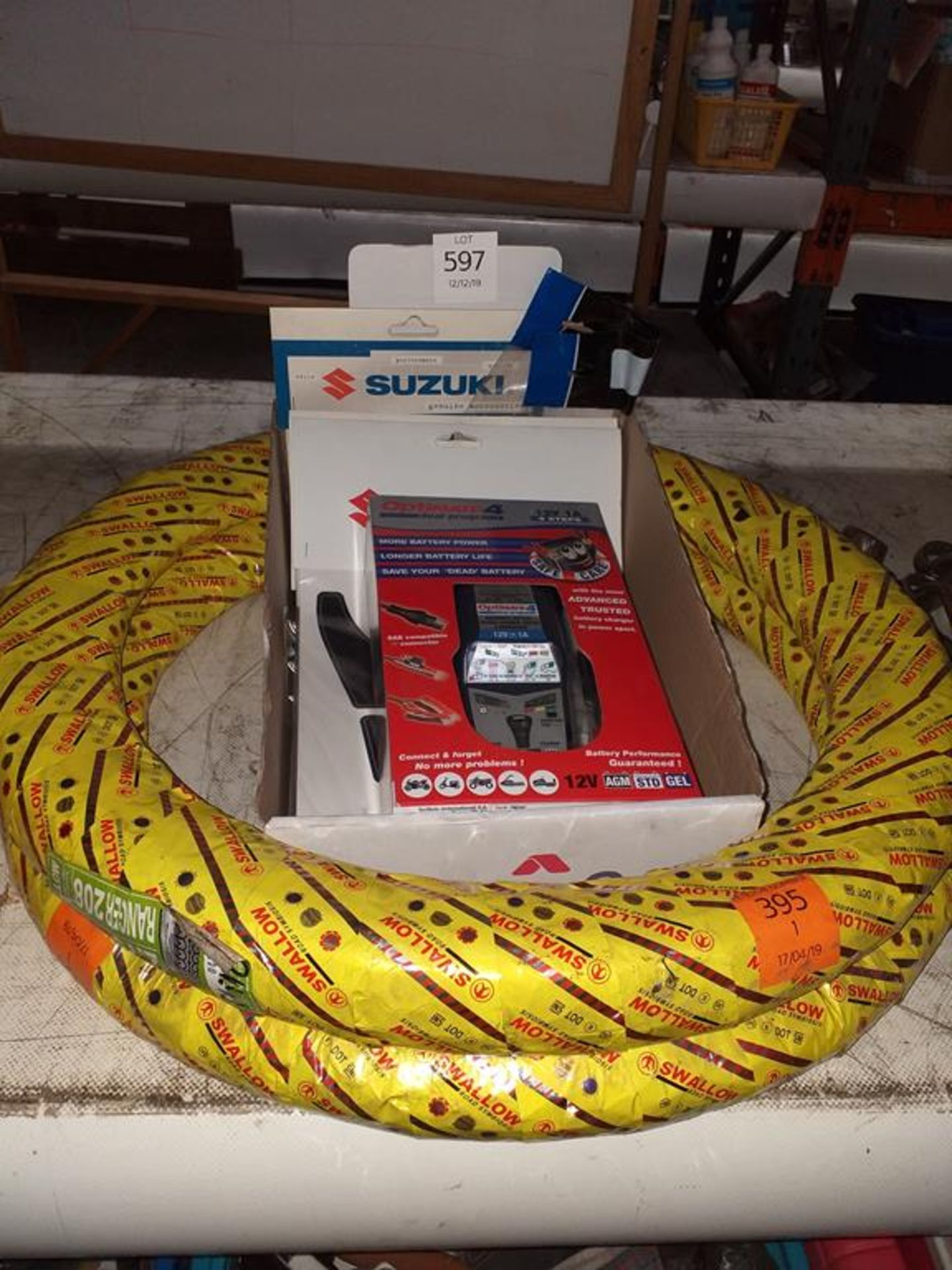 Lot 597 - Tyres, Optimate Battery Charger and a Quantity of Suzuki Decals