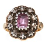 AN ANTIQUE TOURMALINE AND DIAMOND RING, 19TH CENTURY in yellow gold and silver, the step cut pink