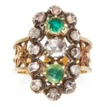 AN ANTIQUE EMERALD AND DIAMOND RING in high carat yellow gold, jewelled with two round cut