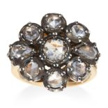 AN ANTIQUE DIAMOND CLUSTER RING in yellow gold and silver, set with a cluster of nine rose cut