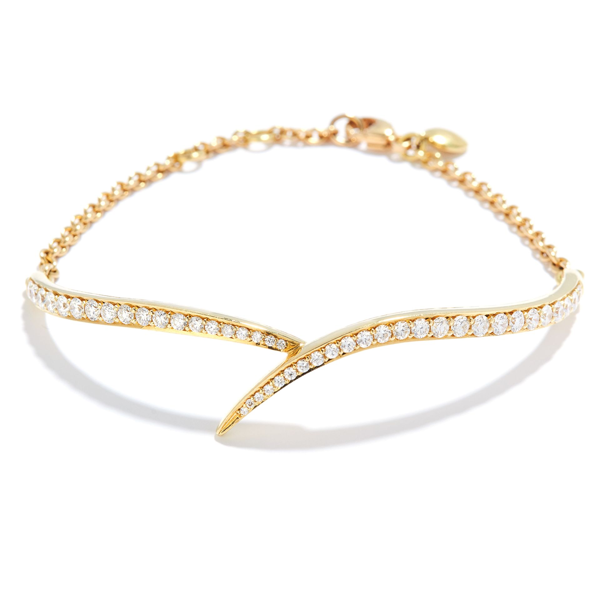 DIAMOND BRACELET, SEANE LEANE in 18ct yellow gold, set with a row of round cut diamonds in half
