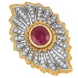 RUBY AND DIAMOND CLUSTER RING set with a round cut ruby of approximately 2.16 carats in a border