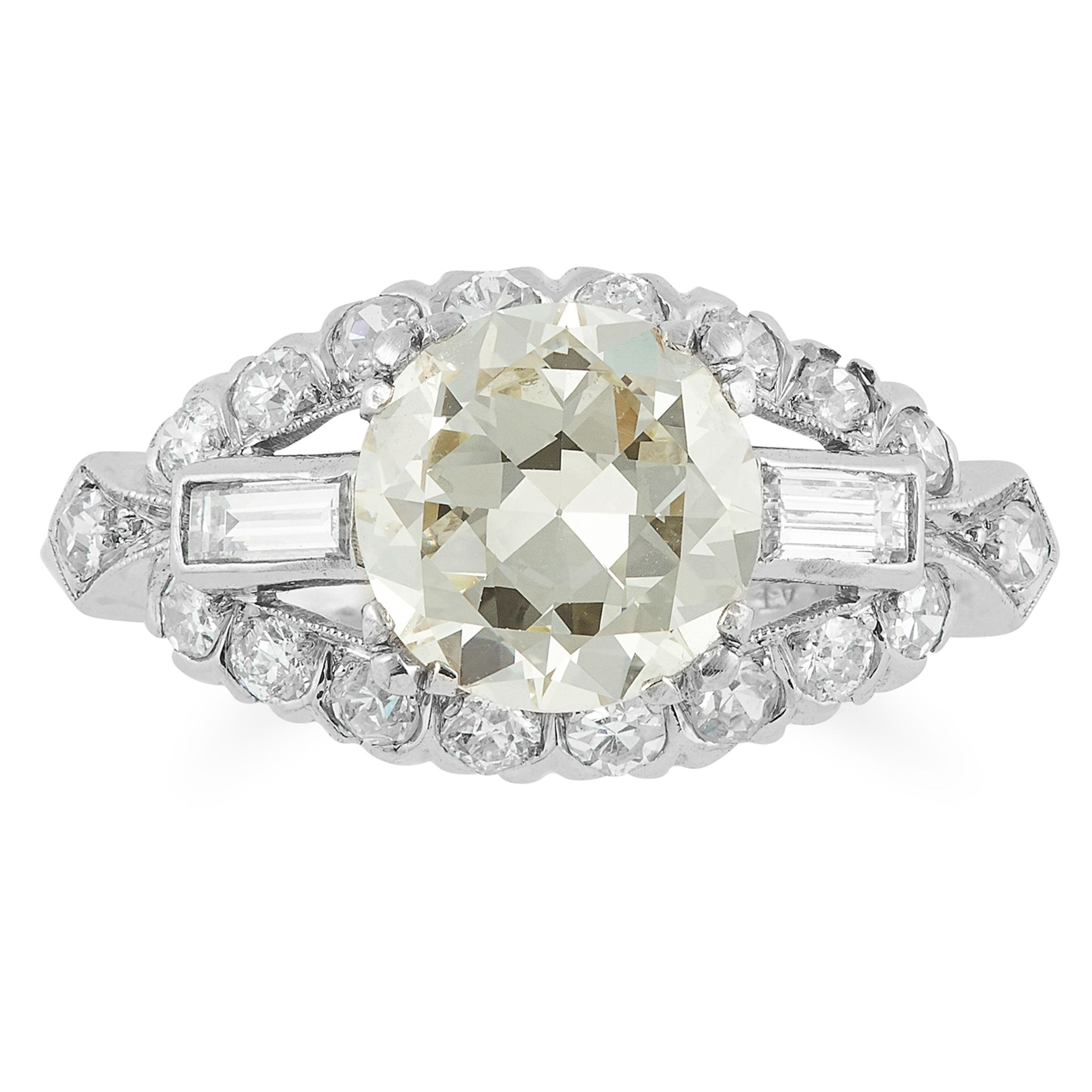 DIAMOND DRESS RING set with a transitional cut diamond in a border of baguette and round diamonds,