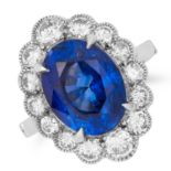 5.96 CARAT SAPPHIRE AND DIAMOND CLUSTER RING set with an oval cut sapphire of approximately 5.96