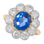 3.65 CARAT CEYLON NO HEAT SAPPHIRE AND DIAMOND CLUSTER RING set with an oval cut sapphire of 3.65