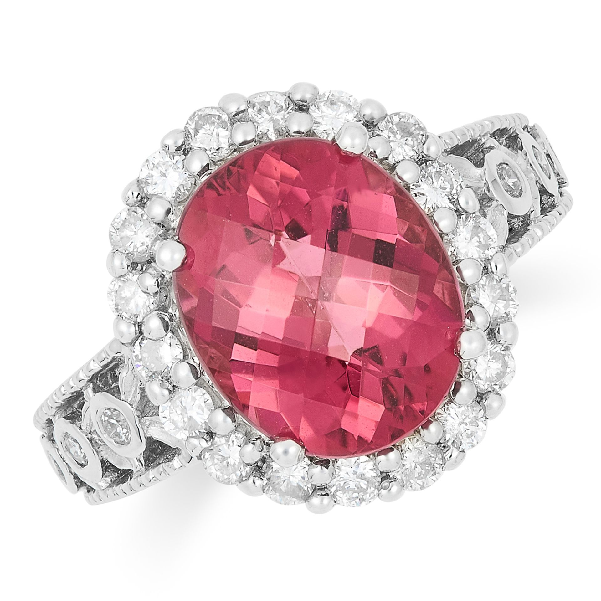 PINK TOURMALINE AND DIAMOND DRESS RING, set with a faceted oval cut tourmaline and round cut