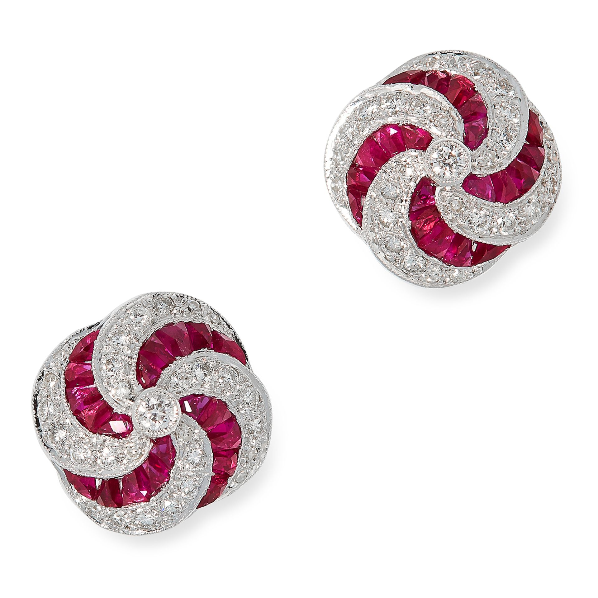 RUBY AND DIAMOND STUD EARRINGS in twisted design set with step cut rubies and round cut diamonds,