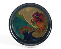 Kleine SchaleHolland, Gouda, am Boden schwarze Pinselmarke. Runde, flache Form. Blauschwarze und