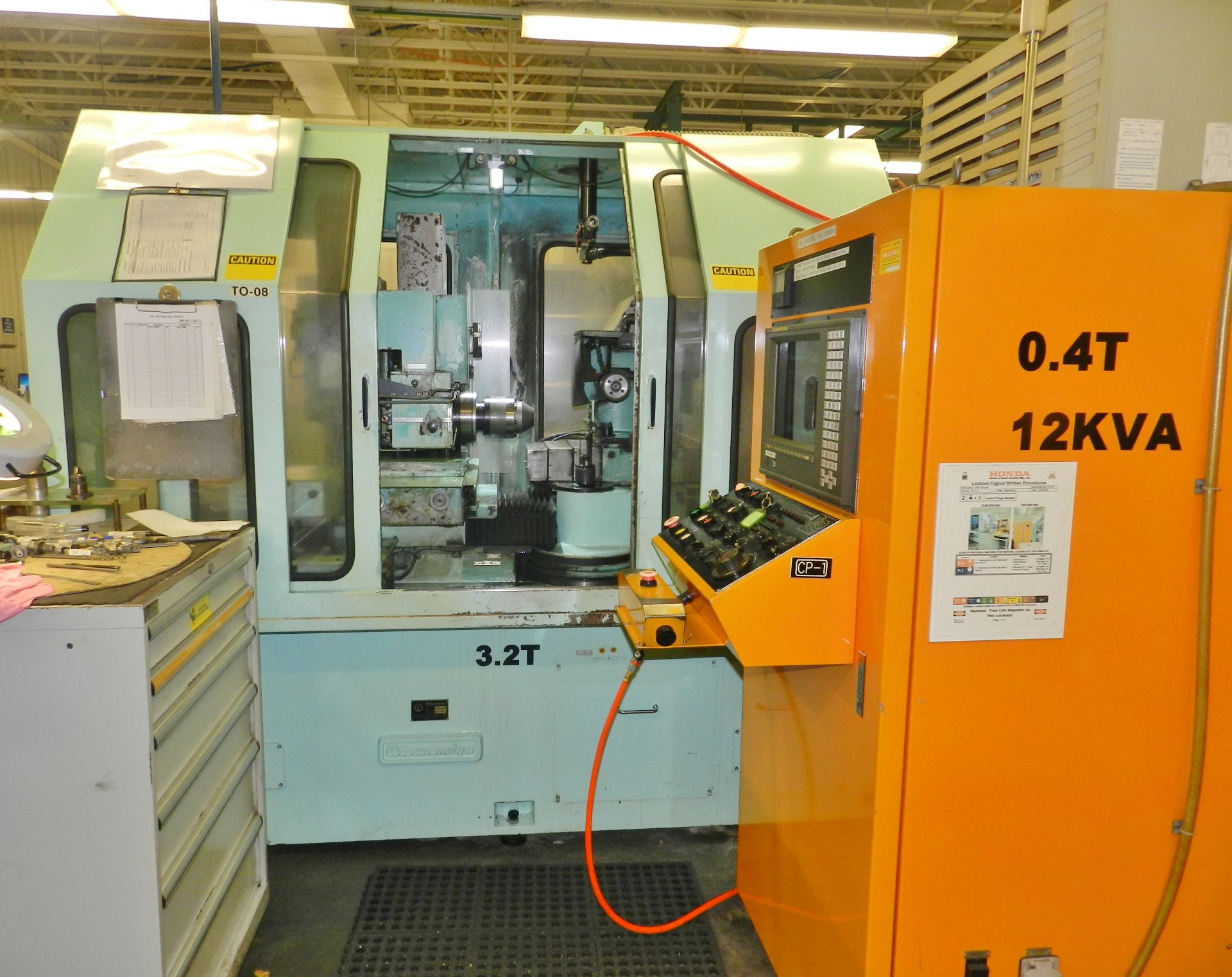 Lot 38 - UTSUNOMIYA SEISAKUSHO Co 6 Axis CNC Tool Cutter Machine UTG150-15M Fanuc Control