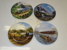 A GROUP OF FOUR RAILWAY RELATED PLATES FEATURING DIFFERENT STEAM LOCOMOTIVES AND VIEWS as lotted