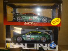 A PAIR OF 1:18 SCALE DIECAST MODEL RACING CARS both ASTON MARTIN DBR9 24H LE MANS RACING CARS, one
