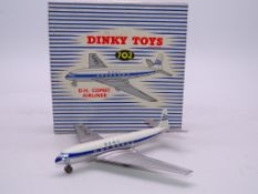 DINKY DIECAST AIRCRAFT: A 702 'DH COMET JET AIRLINER BOAC' - VG/E IN VG BOX WITH PACKING PIECE