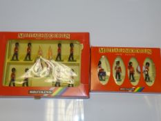 A PAIR OF BRITAINS METAL MODELS SOLDIER SETS to include 7210 SCOTS GUARDS DRUM and BUGLE SET and