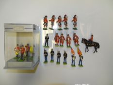 A GROUP OF MODEL SOLDIERS BY BRITAINS to include HRH QEII on horseback and THE MIDDLESEX REGIMENT as