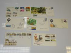 A SMALL QUANTITY OF ROYAL MAIL FIRST DAY COVERS FEATURING DIFFERENT RAILWAY THEMED SETS as
