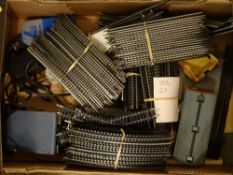 HO/OO GAUGE - A large tray of track, controllers and accessories. G-VG N.B. To comply with auction