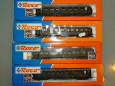 HO GAUGE - A group of Roco coaches in DB/DRG green