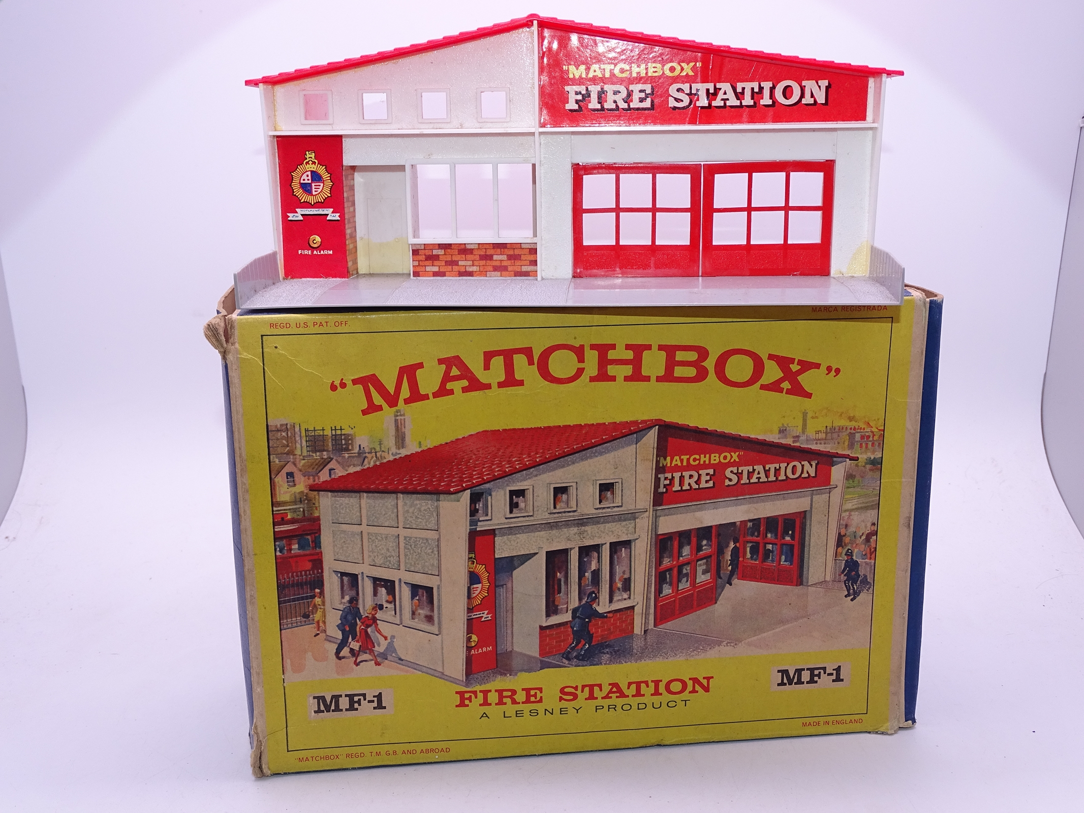 Lot 9 - A Matchbox MF-1 Fire Station, with red roof and red doors and frontage. G-VG in generally G box.