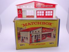 A Matchbox MF-1 Fire Station, with red roof and red doors and frontage. G-VG in generally G box.