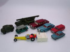 A group of unboxed playworn vintage Dinky cars and military vehicles. F-G, unboxed. (8)