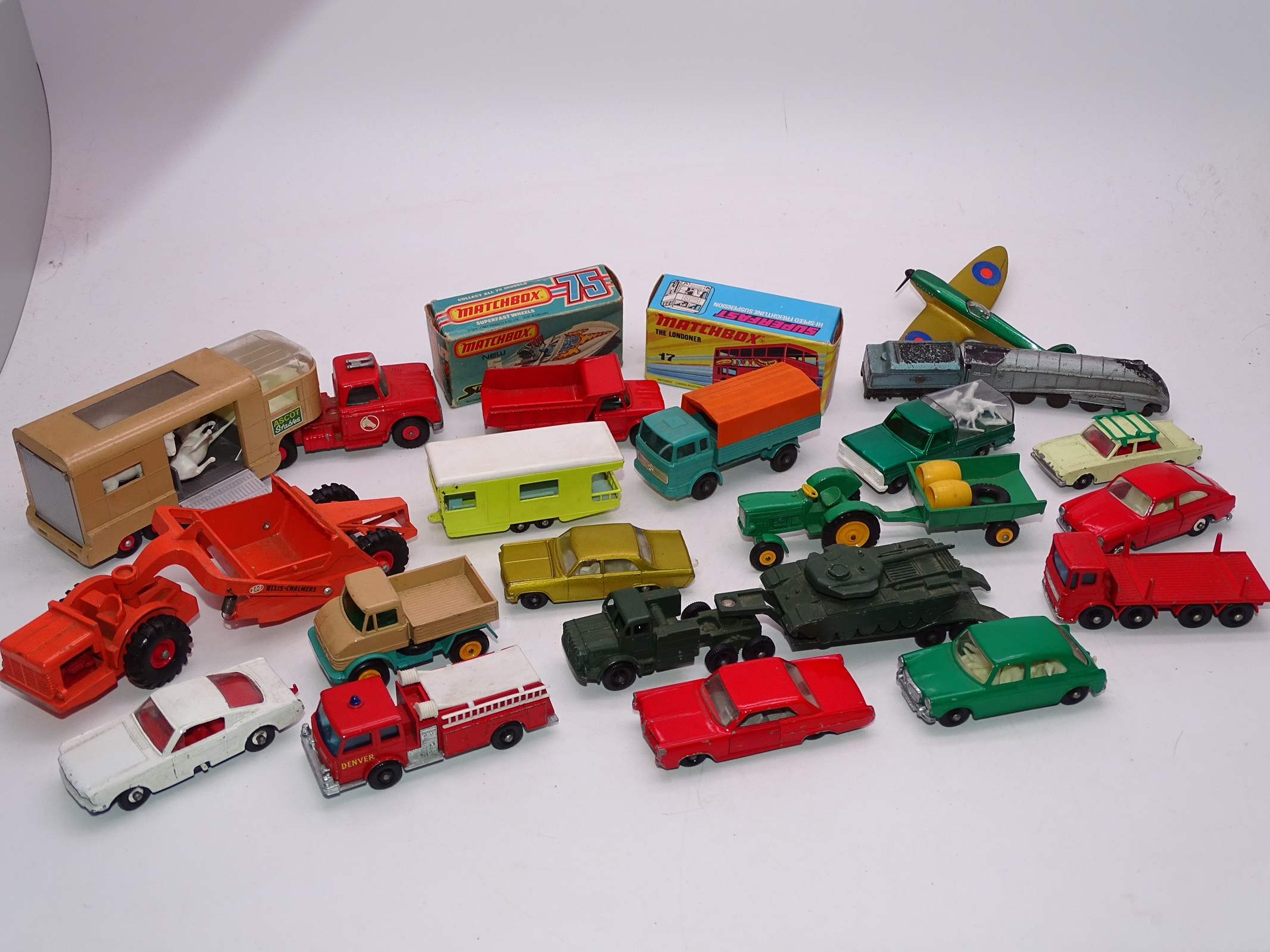 Lot 8 - A group of mostly unboxed playworn vintage Matchbox cars, trucks, etc. F-G, unboxed (19), boxed. (