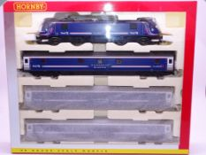 OO Gauge -A Hornby R2663A 'Caledonian Sleeper' train pack including electric loco and 3 coaches - E,