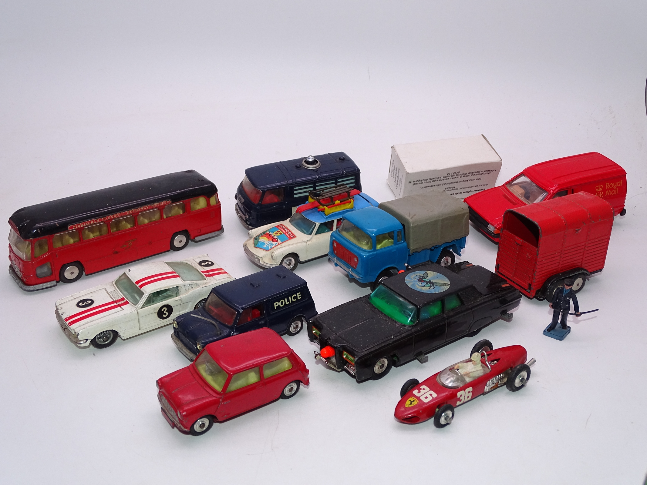 Lot 4 - A group of unboxed playworn vintage Corgi cars, trucks and bus. F-G, unboxed. (12)
