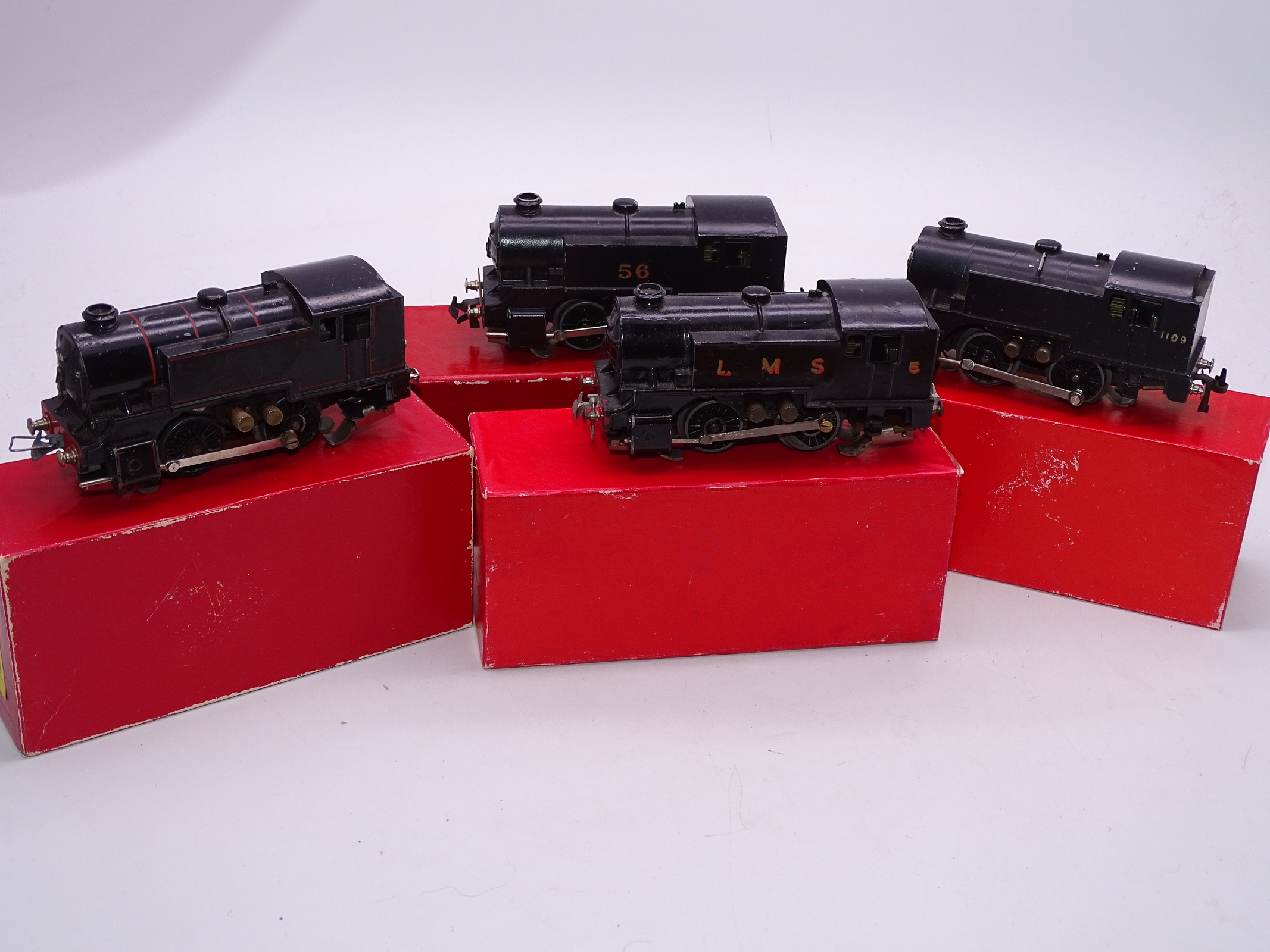 Lot 28 - OO Gauge -A group of playworn Trix Twin 0-4-0 steam tank locomotives in various liveries supplied in