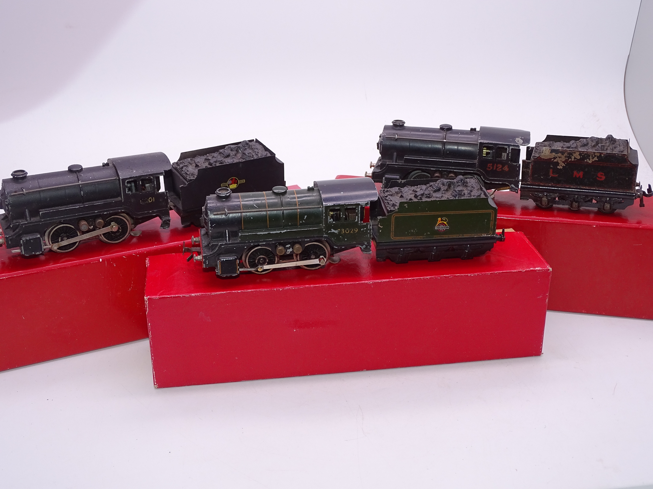 Lot 27 - OO Gauge - A group of playworn Trix Twin 0-4-0 steam tender locomotives in various liveries supplied