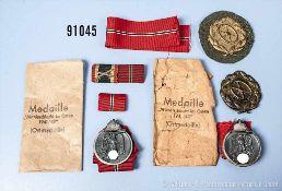 Konv. 2 Ostmedaillen mit 2 Verleihungstüten, 2 Kraftfahr-Bewährungsabzeichen in Bronze sowie 2