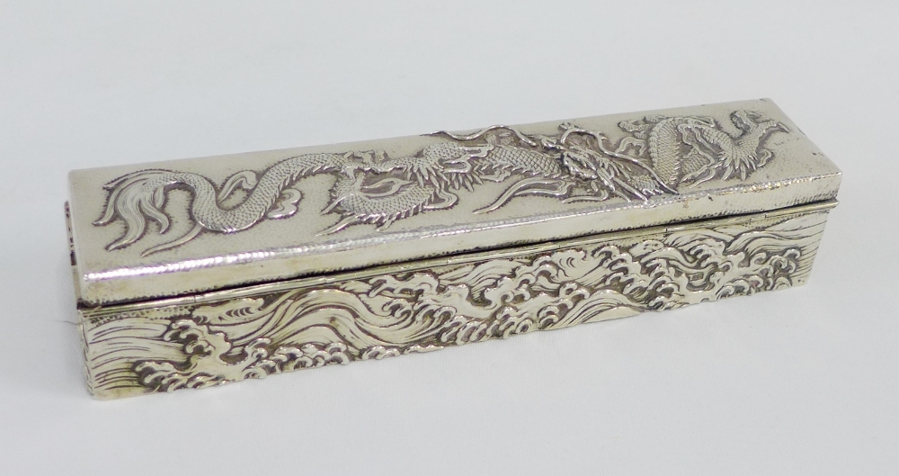 Lot 12 - Chinese silver box and cover of rectangular form with repousee dragon and cloud pattern, 23 x 5cm