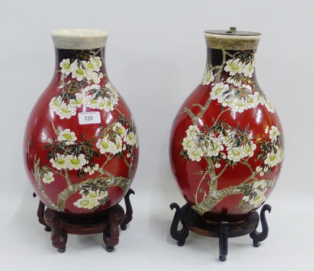 Lot 330 - Pair of Japanese earthenware baluster vases, one with a lamp fitting to top, both with hardwood