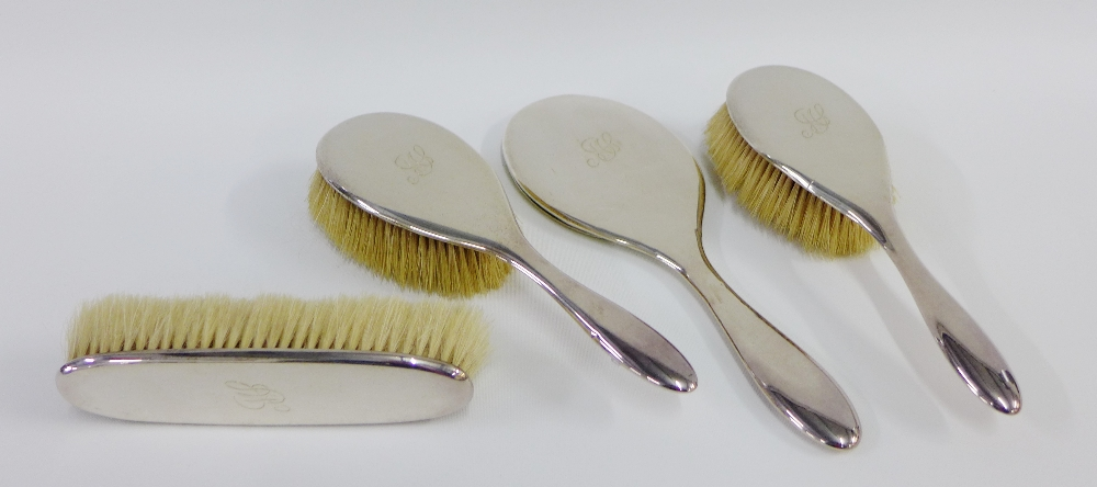 Lot 18 - George V silver backed dressing table brush set comprising two hair brushes, clothes brush and
