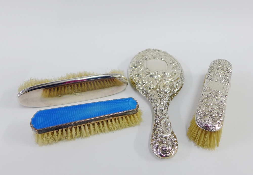 Lot 31 - Silver backed hand mirror and two silver backed clothes brushes together with an Epns and enamel