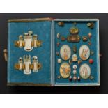 A COLLECTION OF MINIATURE COLLECTIBLES IN CASEIvory, gold, painting, enamel, pearls, etc.Mostly
