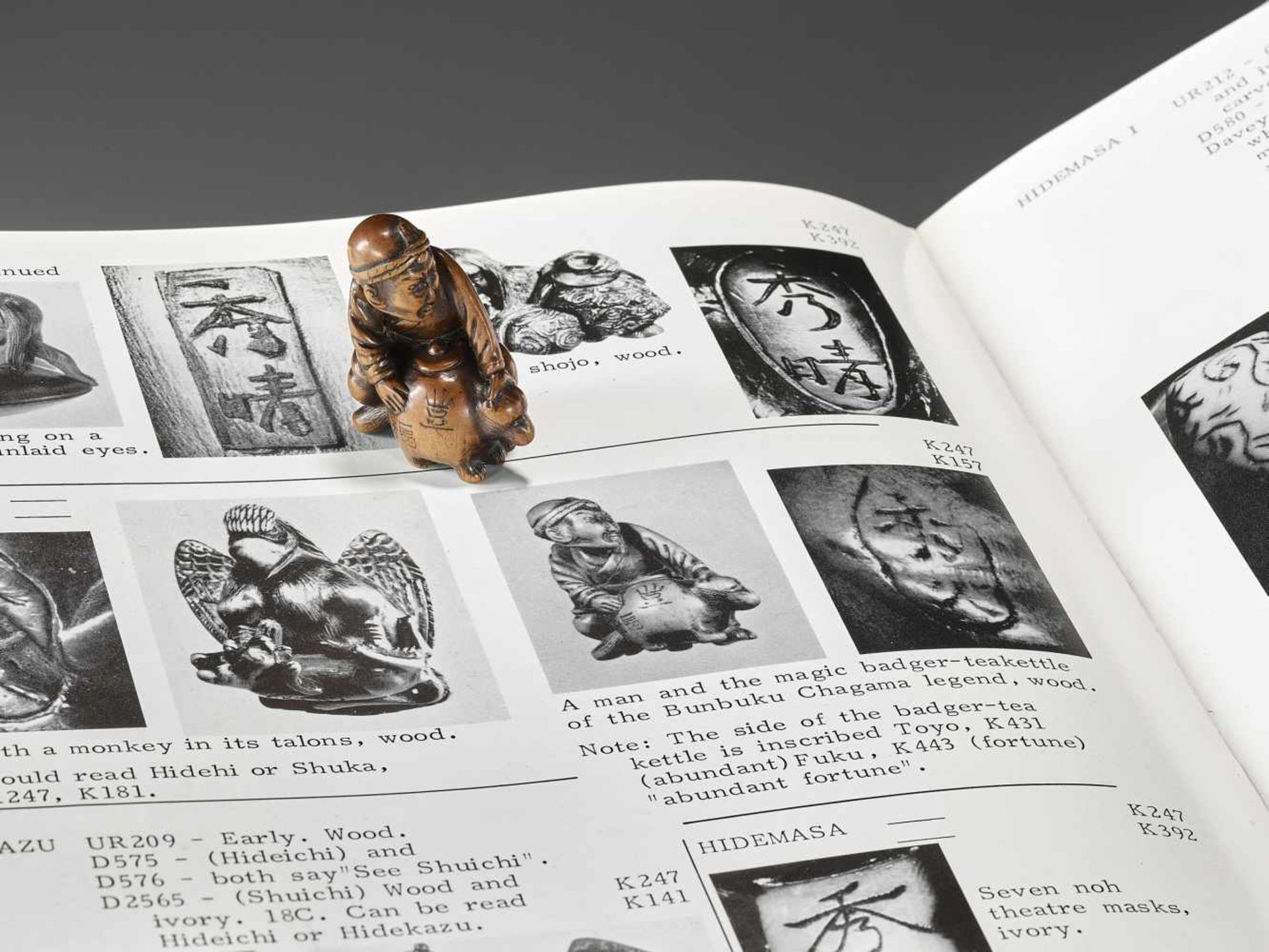 HIDEHISA: A RARE WOOD NETSUKE OF A THIEF STEALING THE MAGIC TANUKI KETTLE By Hidehisa, signed - Image 2 of 12