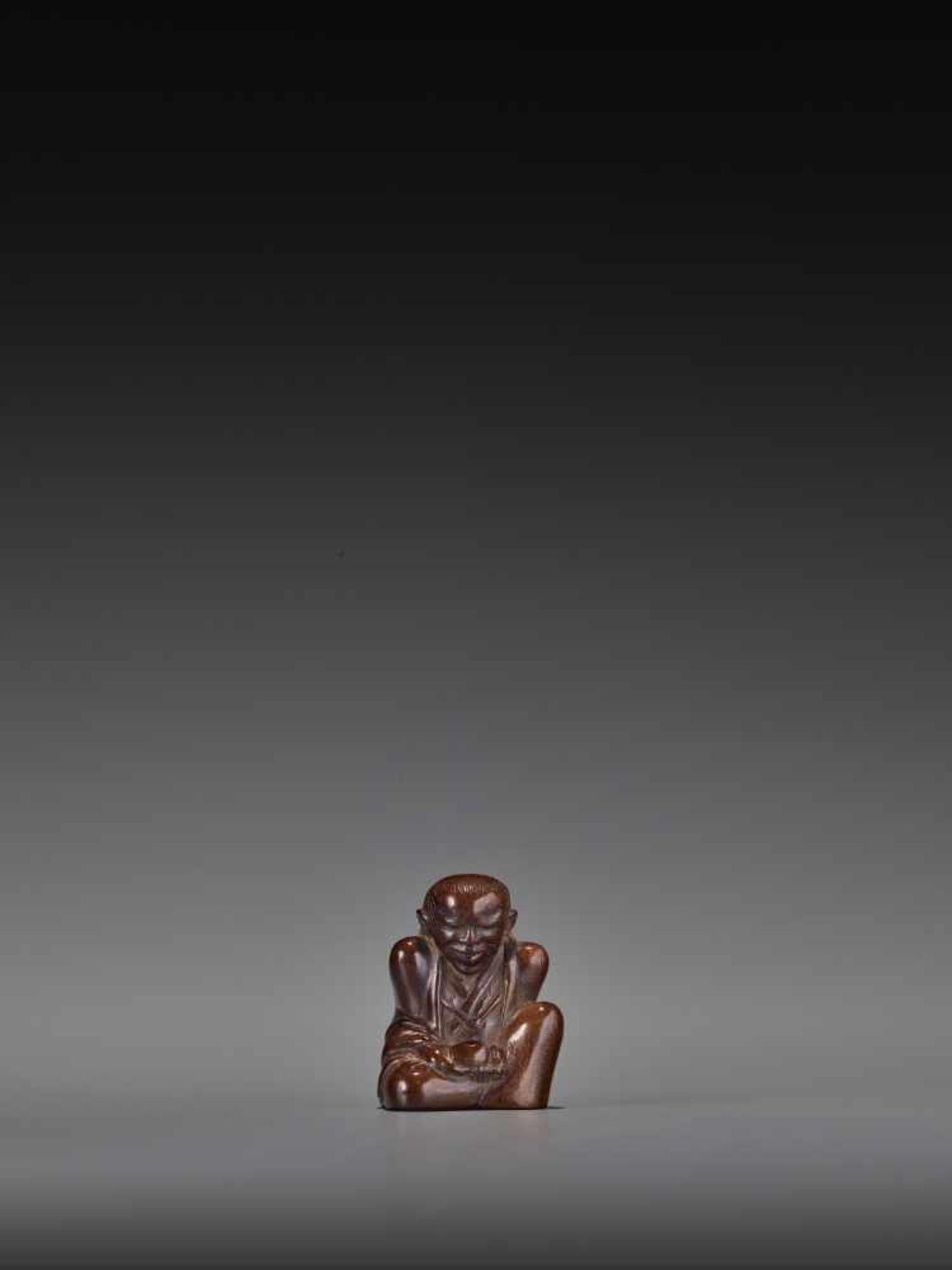 MIWA: A RARE WOOD NETSUKE OF CHAJIN By Miwa I (Yukan), signed Miwa with kakihanJapan, Edo, mid-